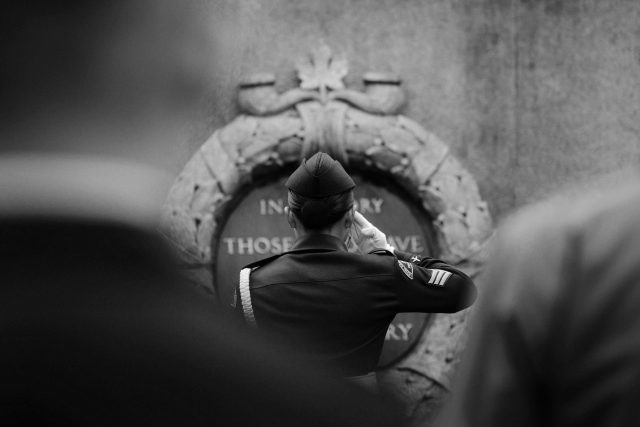 Cadet saluting the memorial at victory square in Vancouver on remembrance day