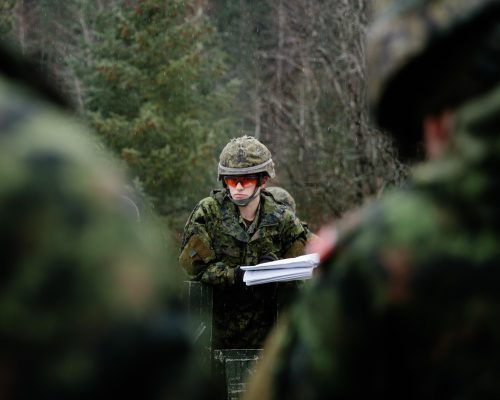Canadian Army combat engineer Master Corporal oversees the assembly of a Medium Girder Bridge