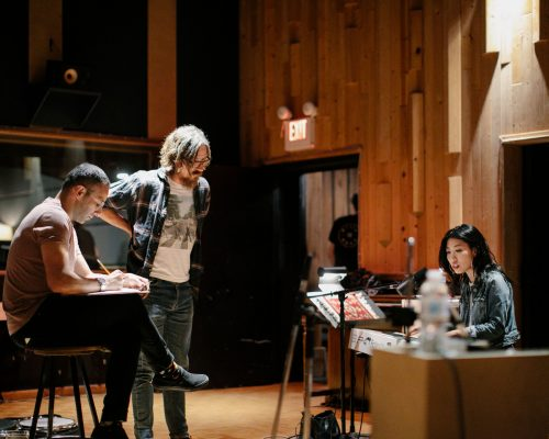 Vancouver based singer songwriter Wanting Qu in the recording studio with her band