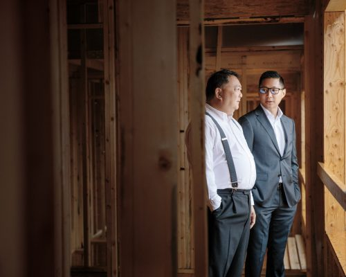 Two men conduct a site visit of a property under construction in Vancouver, British Columbia