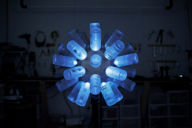 Interactive LED sculpture built from Absolut vodka bottles by Tangible interaction