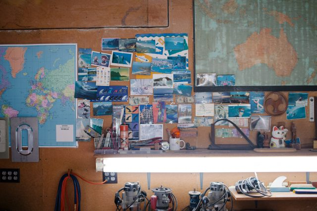 Photographs and maps on the wall of Guy Okazaki's workshop in Venice Beach