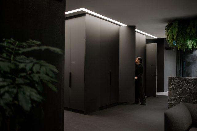 Female opens closet in modern office
