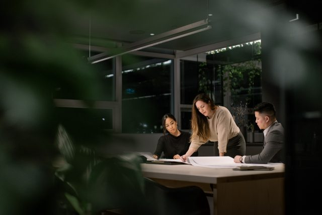 Female manager meets with her team in modern conference room