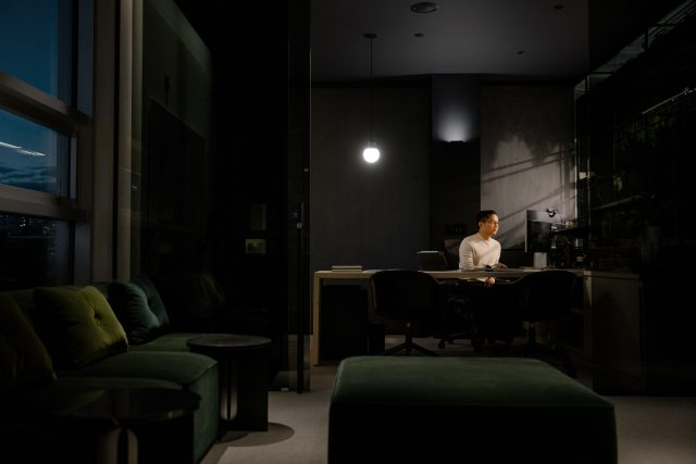 Young asian male executive works on his computer in his office